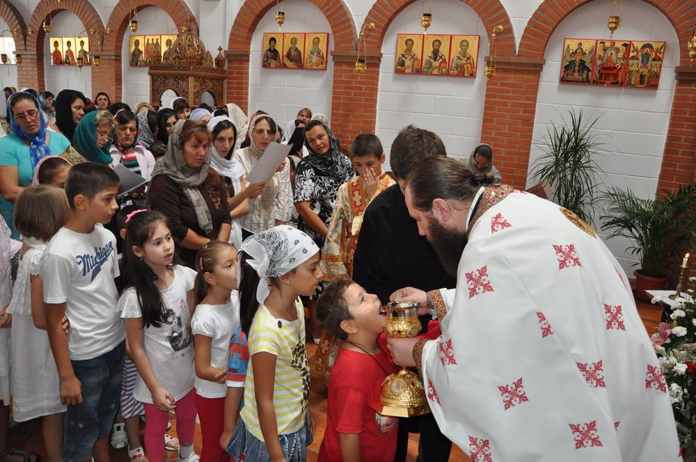 copiii participa la Cina Domnului