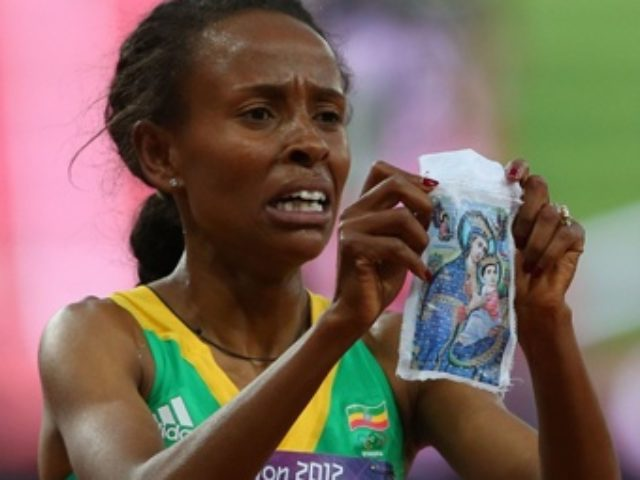 meseret_defar_of_ethiopia_wins_gold_in_the_womens_5000m_final_credit_alexander_hassenstein_getty_images_sport_getty_images_cna_us_catholic_news_8_10_12