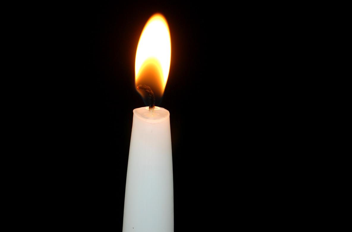5297447-white-candle-burning